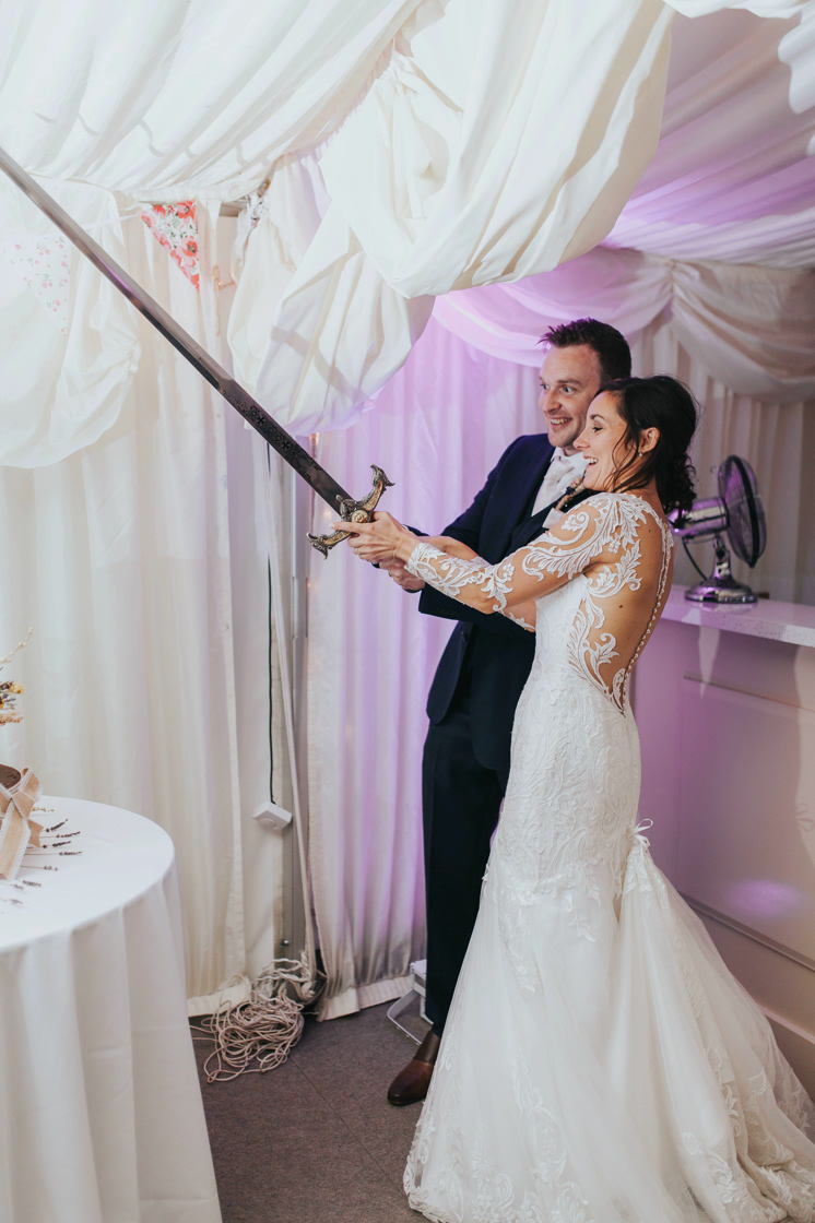 wedding cut cake sword kent