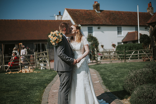 Bride and Groom Kissing at The Ferry House Inn Kent Wedding