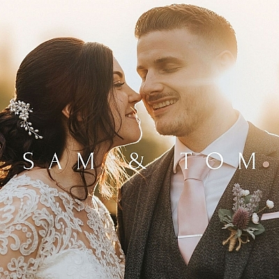 bride kissing groom at hazy sunset wedding picture